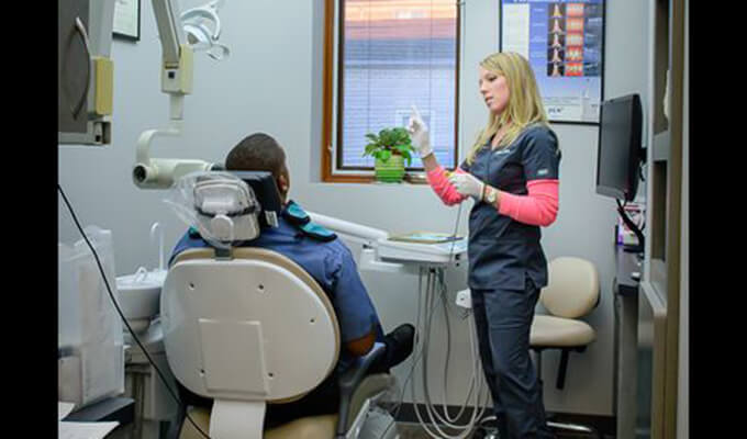Kristin working with patient