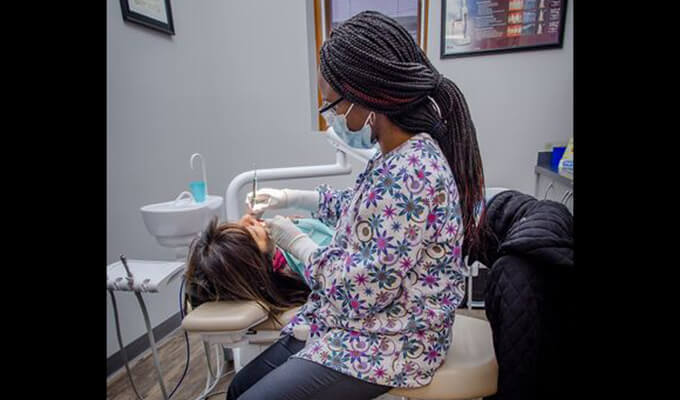 Sanchia working on patient's smile