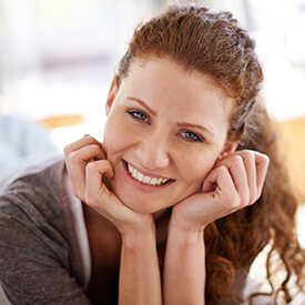 red headed woman smiling