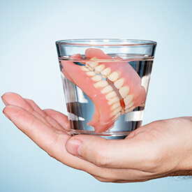 dentures in glass or water
