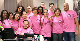 dental team wearing breast cancer shirts