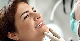 dentist holding up woman's smile