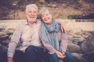Older couple smiling with dental implants in Roselle Park